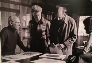 "Edward Weston, Brett Weston, Ansel Adams and Dody Warren, selecting photos for Weston's ""My Camera at Point Lobos,"" Wildcat Hill, Carmel, 1949. Photo by Cameron Macauley."
